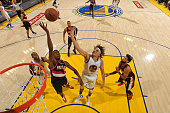 Anderson Varejao of the Golden State Warriors shoots a layup during the game against AlFarouq Aminu of the Portland Trail Blazers in Game Two of the...