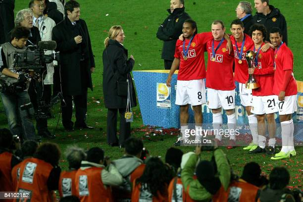 Anderson Wayne Rooney Cristiano Ronaldo Rafael Da Silva and Nani of Manchester United pose with a trophy for photographer at a ceremony after the...