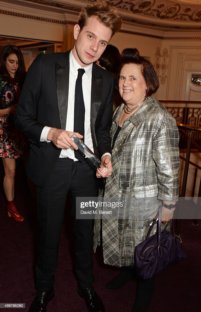 J.W. Anderson (L), winner of the Menswear Award, and Suzy Menkes attend the British Fashion Awards at the London Coliseum on December 1, 2014 in London, England.
