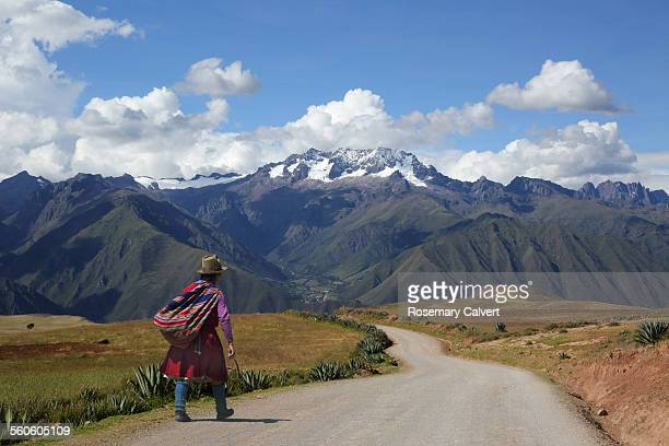 Andes and Urubamba Valley with traditional woman