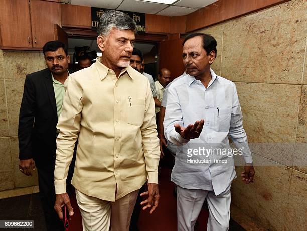 Andhra Pradesh Chief Minister Chandrababu Naidu and Telangana Chief Minister K Chandrashekar Rao leave after a high level meeting with Union Water...