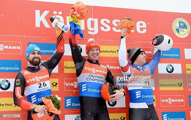 Andi Langhan of Germany Felix Loch of Germany and Chris Mazdzer of the United States pose at the podium after the Men's FIL Luge World Cup Koenigssee...