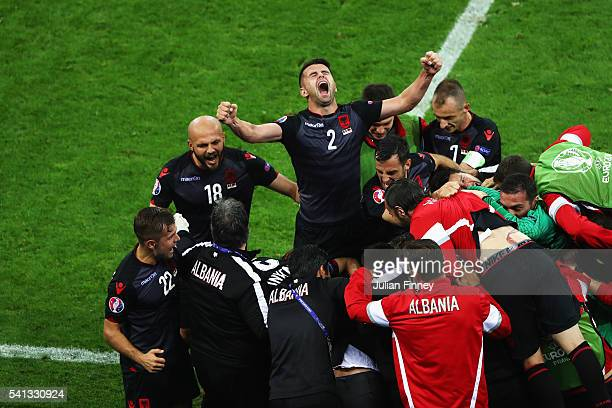 Andi Lila of Albania celebrates his team's first goal scored by Armando Sadiku during the UEFA EURO 2016 Group A match between Romania and Albania at...