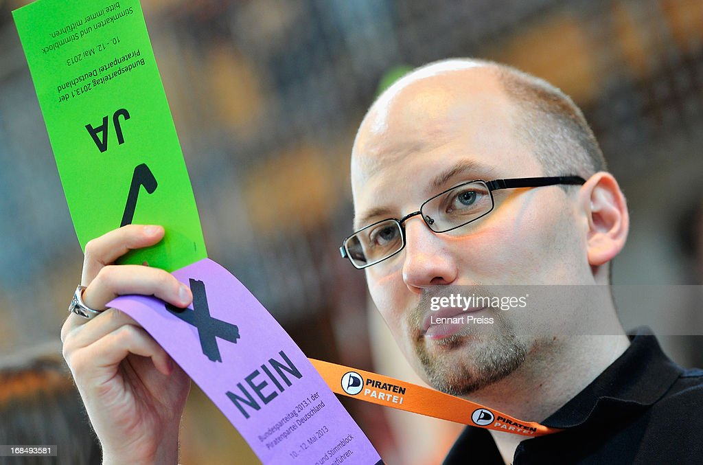 Andi Popp, candidate for the political manager of the German Pirates Party (Die Piraten) holds his voting cards during the party's federal congress on May 10, 2013 in Neumarkt, Germany. The Pirates rode a wave of popularity driven by voter discontent with Germany's established political parties that won the Pirates seats in several state parliaments. More recently, however, the Pirates have faltered, as political infighting, leadership changes and an unclear political message have contributed to a loss of support. Germany faces federal elections in September and at current polls the Pirates would fail to pass the 5% hurdle necessary to gain seats in the Bundestag.