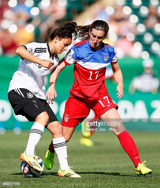 Andi Sullivan of the United States challenges Lina Magull of the Germany at Commonwealth Stadium on August 5 2014 in Edmonton Canada