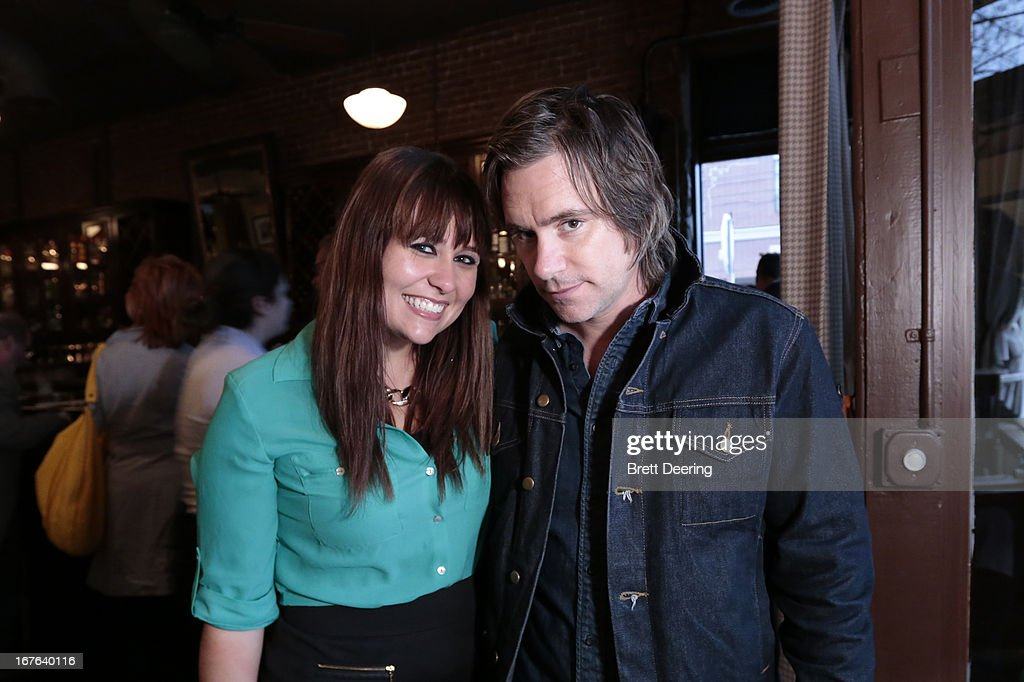 Andie Cox and Johnny Irion pose for photos at an event for the Woody Guthrie Center on April 26, 2013 in Tulsa, Oklahoma.