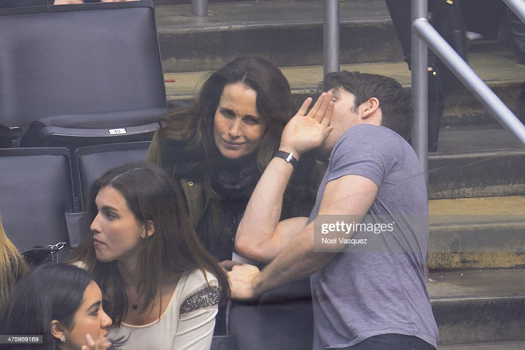 <a gi-track='captionPersonalityLinkClicked' href=/galleries/search?phrase=Andie+MacDowell&family=editorial&specificpeople=204572 ng-click='$event.stopPropagation()'>Andie MacDowell</a> (L) and <a gi-track='captionPersonalityLinkClicked' href=/galleries/search?phrase=Steven+R.+McQueen+-+Born+1988&family=editorial&specificpeople=4069204 ng-click='$event.stopPropagation()'>Steven R. McQueen</a> attend a hockey game between the Carolina Hurricanes and the Los Angeles Kings at Staples Center on March 1, 2014 in Los Angeles, California.