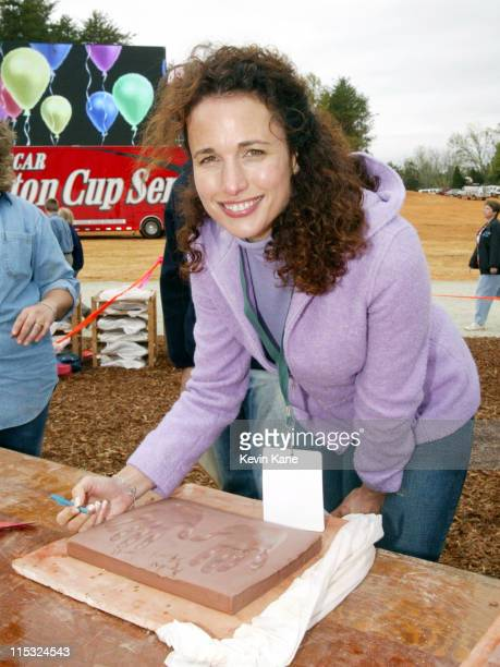 Andie MacDowell autographs her hand impression in clay Her hand impression will represent the hands that help build the foundation for the Victory...