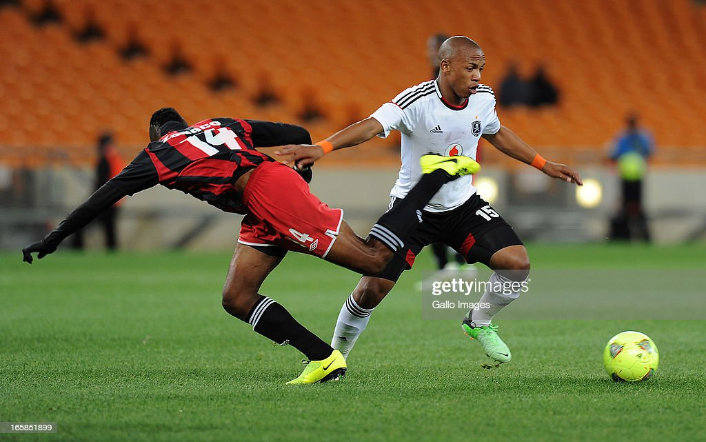 Andile Jali of Orlando pirates battling for the ball with Rodrick Kwabe of Zanaco FC during the CAF Confedaration Cup match between Orlando Pirates and Zanaco at FNB Stadium on April 06, 2013 in Johannesburg, South Africa.