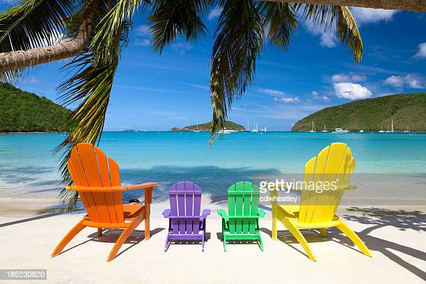 andirondack chairs at a beach in the Caribbean