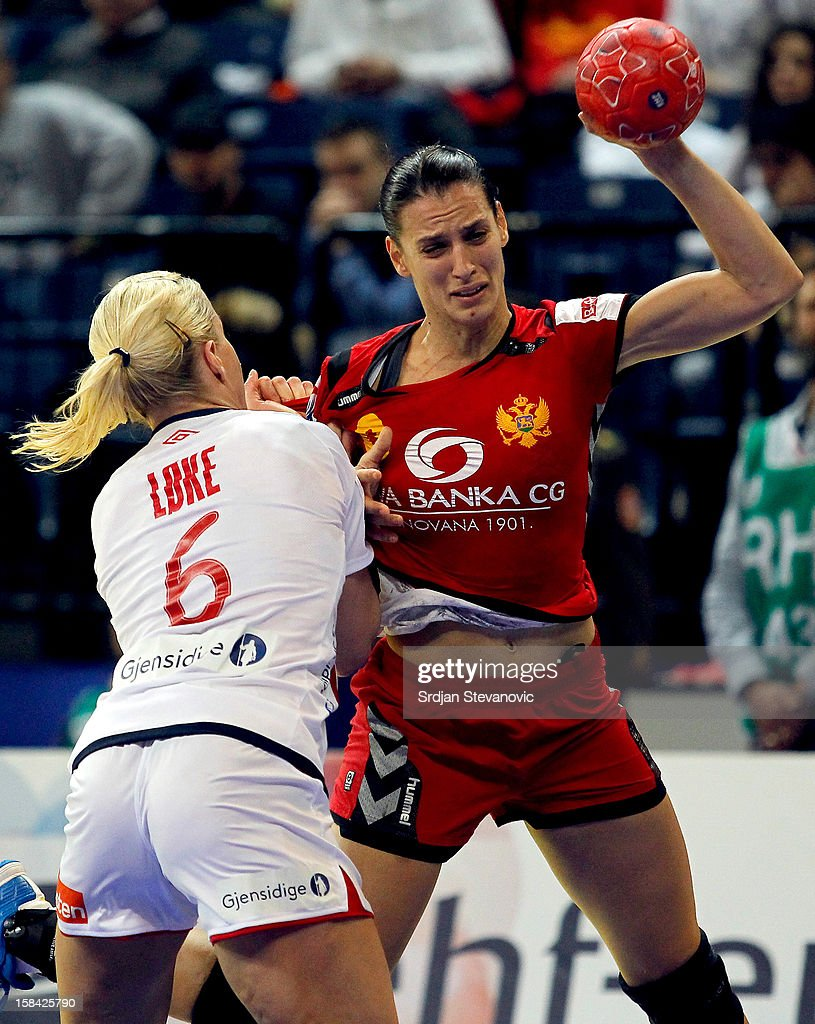 Andjela Bulatovic of Montenegro (R) is challenged by Heidi Loke (L) of Norway during the Women's European Handball Championship 2012 gold medal match between Norway and Montenegro at Arena Hall on December 16, 2012 in Belgrade, Serbia.