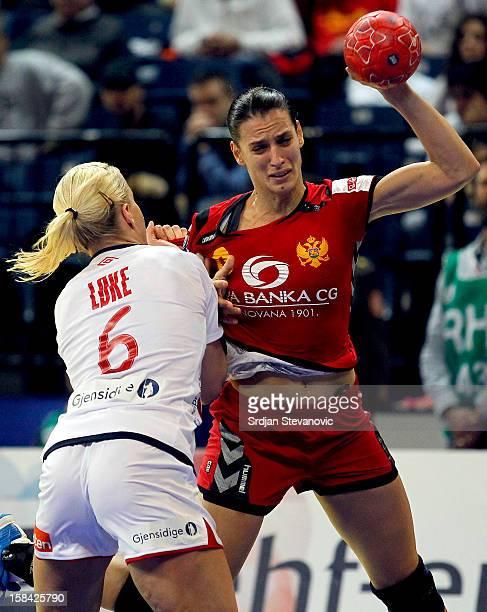 Andjela Bulatovic of Montenegro is challenged by Heidi Loke of Norway during the Women's European Handball Championship 2012 gold medal match between...