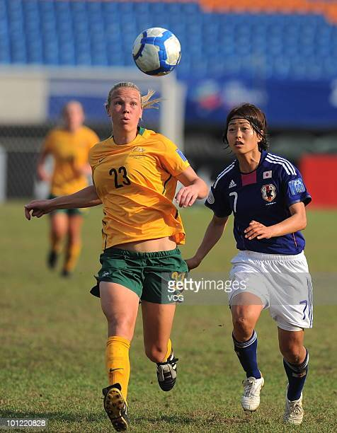 Ando Kozue of Japan competes with Kim Marie Carroll of Australia during the semifinal between Japan and Australia of AFC Women's Asian Cup on May 27...