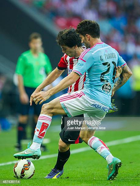 Andoni Iraola of Athletic Club duels for the ball with Carles Planas of Celta de Vigo during the La Liga match between Athletic Club and Celta de...
