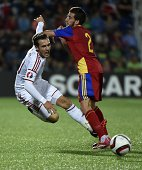 Andorra defender Cristian Martinez vies with Wales forward Aaron Ramsey during the Euro 2016 qualifying round football match Andorra vs Wales on...