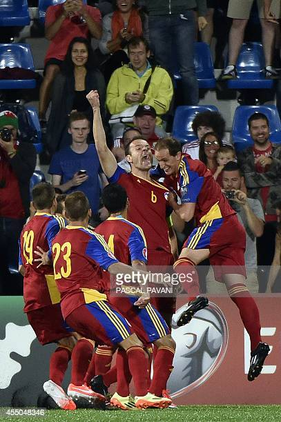 Andorra's defender Ildefons Lima celebrates with teammates after scoring a goal during the Euro 2016 qualifying round football match Andorra against...