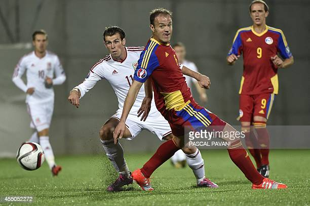 Andorra's defender Ildefons Lima vies with Wales forward Gareth Bale as Andorra's forward Gabi Riera looks on during the Euro 2016 qualifying round...