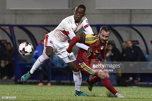 Andorra's defender Marc Pujol vies with Switzerland' midfielder Denis Zakaria during the FIFA World Cup 2018 football qualifier between Andorra and...