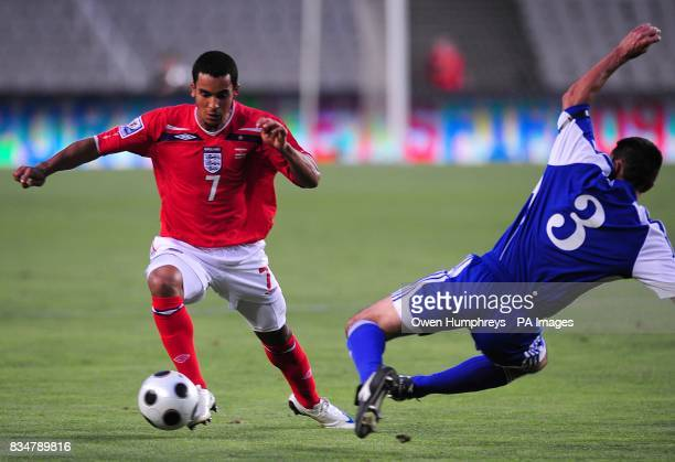 Andorra's Jose Maria Txema and England's Theo Walcott battle for the ball