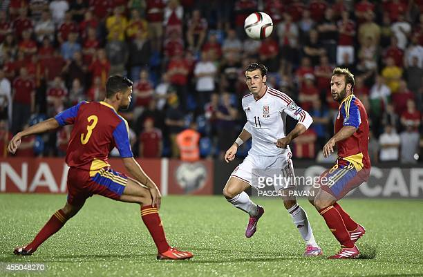 Andorra's midfielder Josep Ayala and Andorra's defender Marc Vales vie with Wales' forward Gareth Bale during the Euro 2016 qualifying round football...
