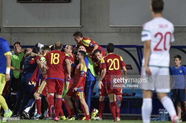 Andorra's players celebrate at the end of the FIFA World Cup 2018 football qualifier between Andorra and Hungary at the Municipal Stadium in Andorra...