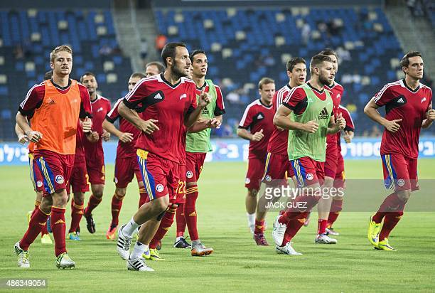 Andorra's players warmup before the start of their Euro 2016 qualifying football match against Israel at the Sammy Ofer Stadium in the Israeli...