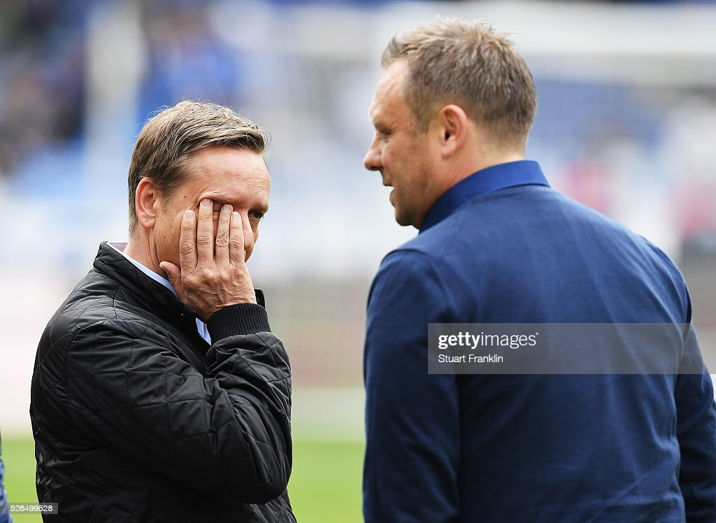 Andr�� Breitenreiter, head coach of Schalke looks on with Horst Held, manager of Schalke during the Bundesliga match between Hannover 96 and FC Schalke 04 at the HDI Arena on April 30, 2016 in Hanover, Lower Saxony.