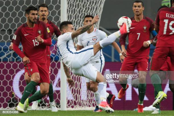 André Gomes Cristiano Ronaldo of the Portugal national football team vie for the ball during the 2017 FIFA Confederations Cup match semifinals...