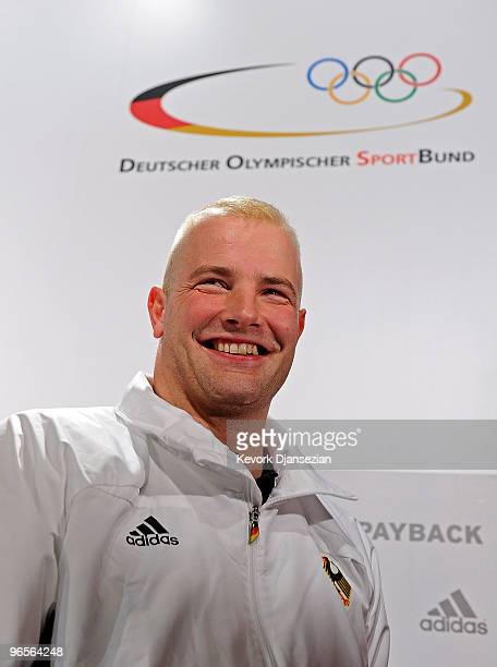 André Lange reacts after a news conference to announce his the flag bearer of the German Olympic team ahead of the Vancouver 2010 Winter Olympics on...