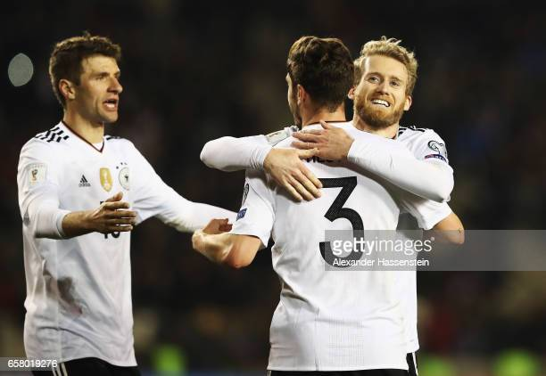 André Schürrle of Germany celebrates scoring the fourth goal with Thomas Mueller and Jonas Hector during the FIFA 2018 World Cup Qualifiying group C...