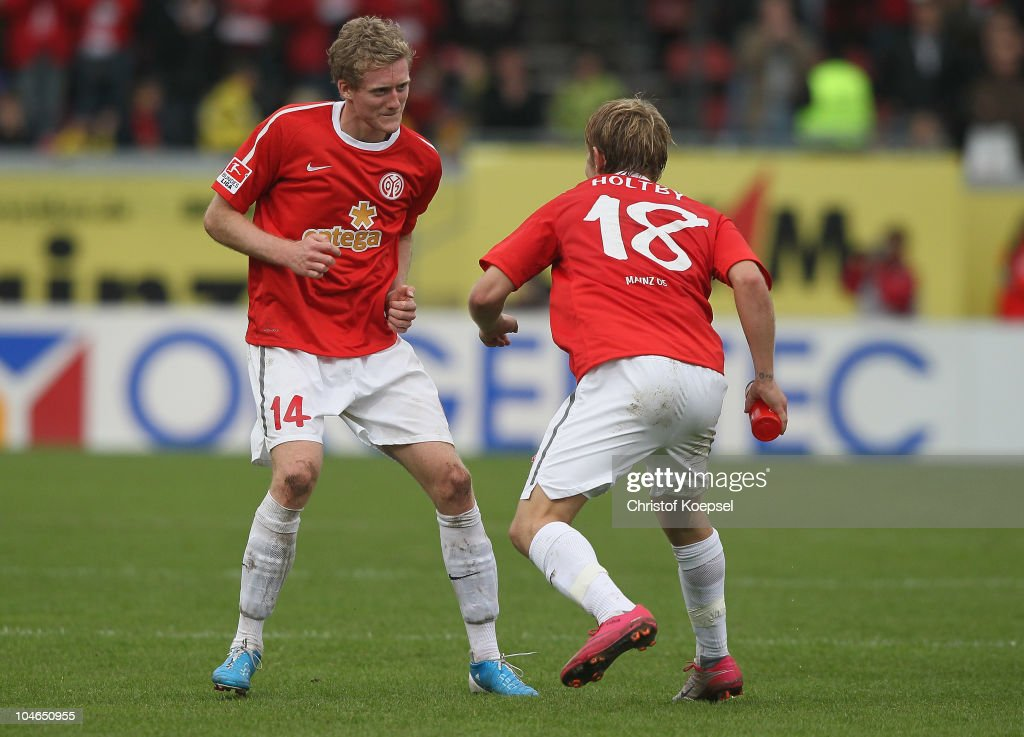 André Schuerrle of Mainz (L) and <a gi-track='captionPersonalityLinkClicked' href=/galleries/search?phrase=Lewis+Holtby&family=editorial&specificpeople=5351202 ng-click='$event.stopPropagation()'>Lewis Holtby</a> celebrate the 4-2 victory after the Bundesliga match between FSV Mainz 05 and 1899 Hoffenheim at Bruchweg Stadium on October 2, 2010 in Mainz, Germany.