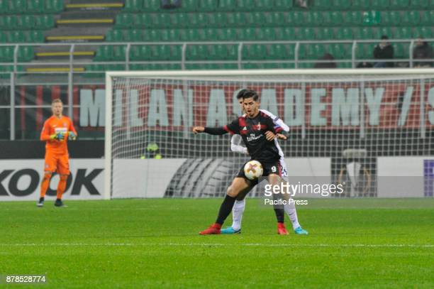 André Silva of AC Milan competes for the ball with Thomas Salamon of FK Austria Wien during uefa Europa League AC Milan vs FK Austria Wien at San...