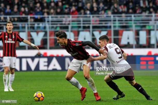 André Silva of AC Milan competes fot the ball with Andrea Bellotti of Torino FC during Italian serie A match AC Milan vs Torino FC at San Siro...