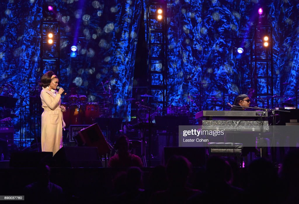 Andra Day and Stevie Wonder perform onstage during Stevie's 21st Annual House Full of Toys Benefit Concert at Staples Center on December 10, 2017 in Los Angeles, California.