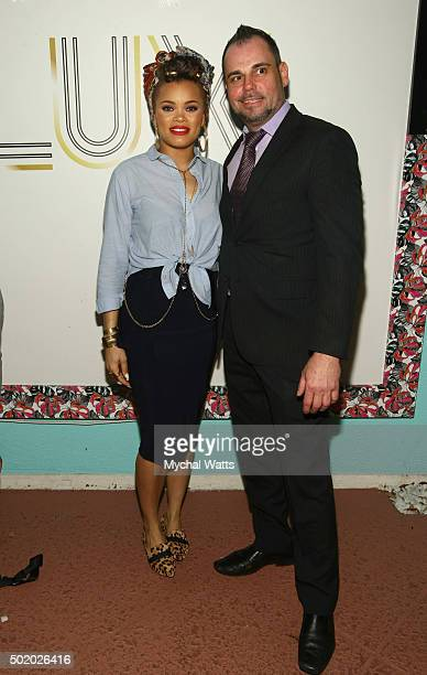 Andra Day poses with Club Lux owner Charlie Droog on December 19 2015 in West Palm Beach Florida