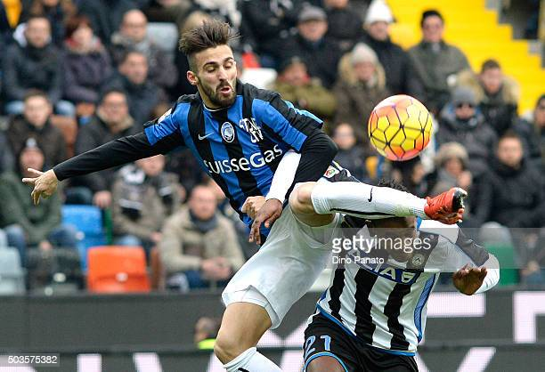 Andrade Edenilson of Udinese Calcio battles for the ball with Marco Dalessandro of Atalanta BC during the Serie A match between Udinese Calcio v...