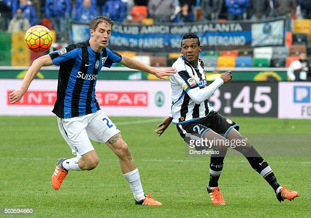 Andrade Edenilson of Udinese Calcio competes with Andrea Conti of Atalanta BC during the Serie A match between Udinese Calcio v Atalanta BC at Stadio...