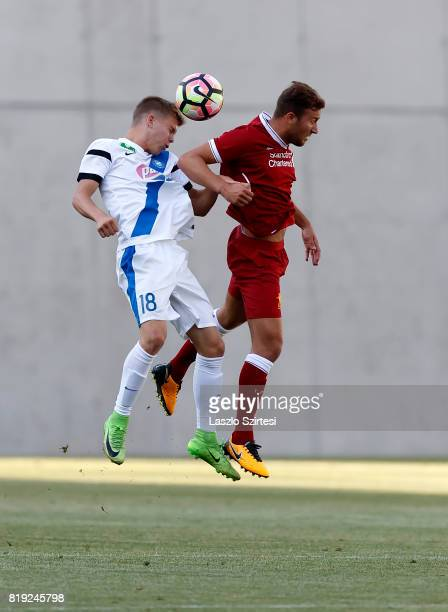 Andras Schafer of MTK Budapest II wins the ball in the air from Herbie Kane of FC Liverpool U23 during the Preseason Friendly match between MTK...