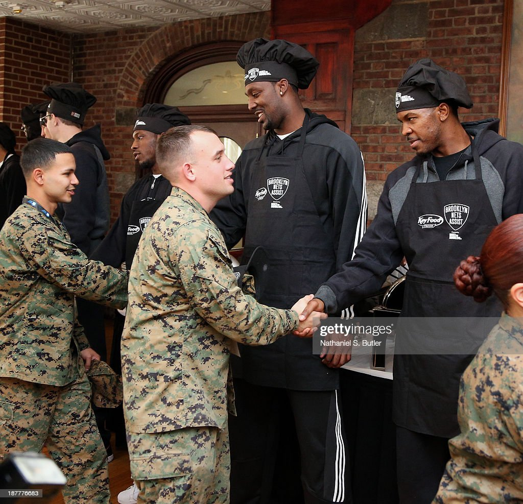 Andray Blatche #0 and Joe Johnson #7 of the Brooklyn Nets poses for a picture during a team event in celebration of Veterans Day at Ft. Hamilton, Brooklyn on November 11, 2013 in the Brooklyn borough of New York City.