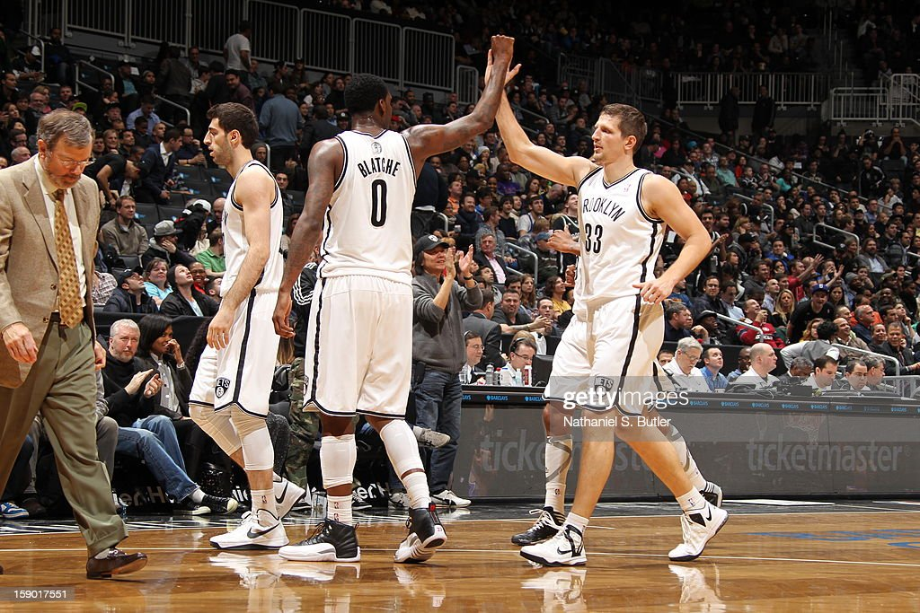 <a gi-track='captionPersonalityLinkClicked' href=/galleries/search?phrase=Andray+Blatche&family=editorial&specificpeople=4282797 ng-click='$event.stopPropagation()'>Andray Blatche</a> #0 and Mirza Teletovic #33 of the Brooklyn Nets congratulate each other during the game against the Sacramento Kings on January 5, 2013 at the Barclays Center in the Brooklyn borough of New York City.