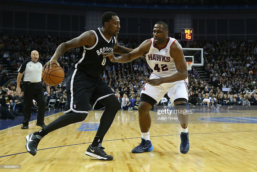 Andray Blatche of Brooklyn and Elton Brand in action during the Eastern Conference NBA match between Brooklyn Nets and Atlanta Hawks at O2 Arena on January 16, 2014 in London, England.