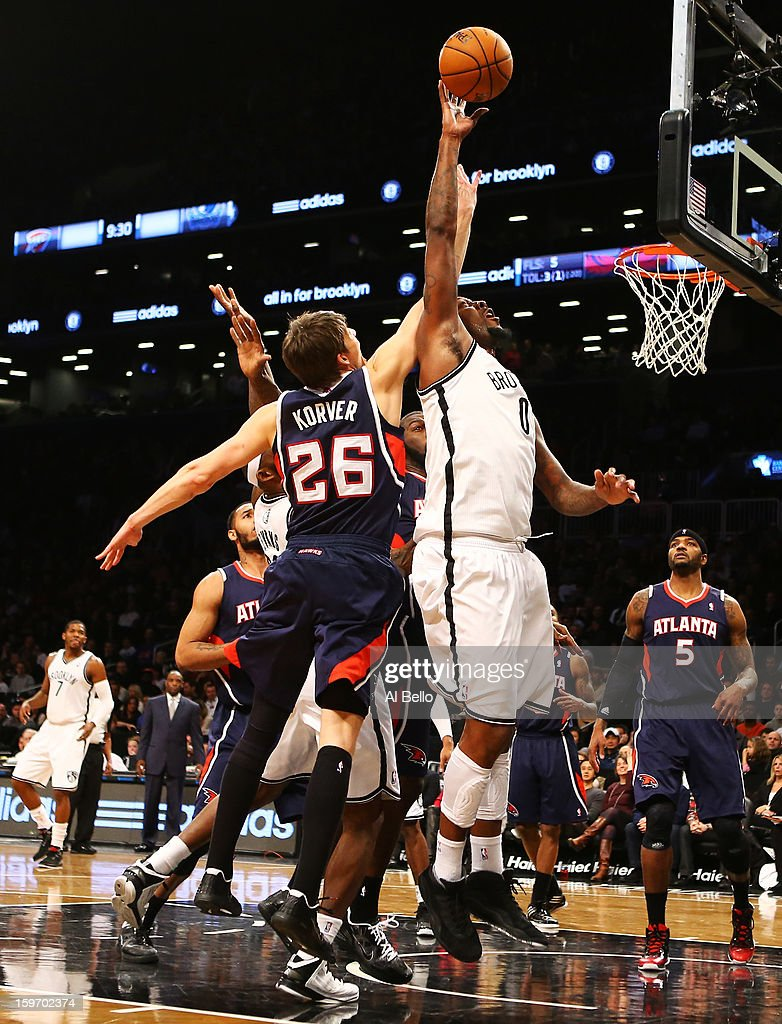 Andray Blatche #0 of the Brooklyn Nets and Kyle Korver #26 of the Atlanta Hawks vie for a rebound in the fourth quarter of the game at Barclays Center on January 18, 2013 in the Brooklyn borough of New York City.