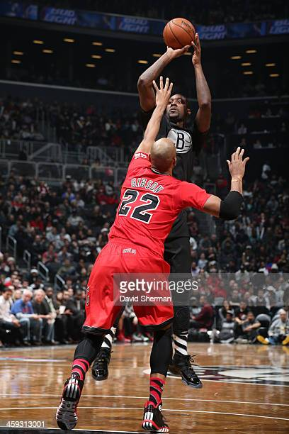 Andray Blatche of the Brooklyn Nets attempts a shot against Taj Gibson of the Chicago Bulls on December 25 2013 at Barclays Center in Brooklyn New...
