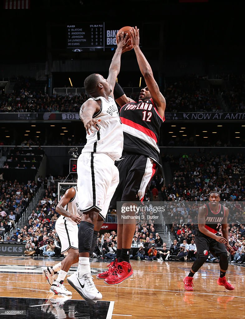 <a gi-track='captionPersonalityLinkClicked' href=/galleries/search?phrase=Andray+Blatche&family=editorial&specificpeople=4282797 ng-click='$event.stopPropagation()'>Andray Blatche</a> #0 of the Brooklyn Nets blocks a shot from <a gi-track='captionPersonalityLinkClicked' href=/galleries/search?phrase=LaMarcus+Aldridge&family=editorial&specificpeople=453277 ng-click='$event.stopPropagation()'>LaMarcus Aldridge</a> #12 of the Portland Trail Blazers during a game at Barclays Center on November 18, 2013 in the Brooklyn borough of New York City.