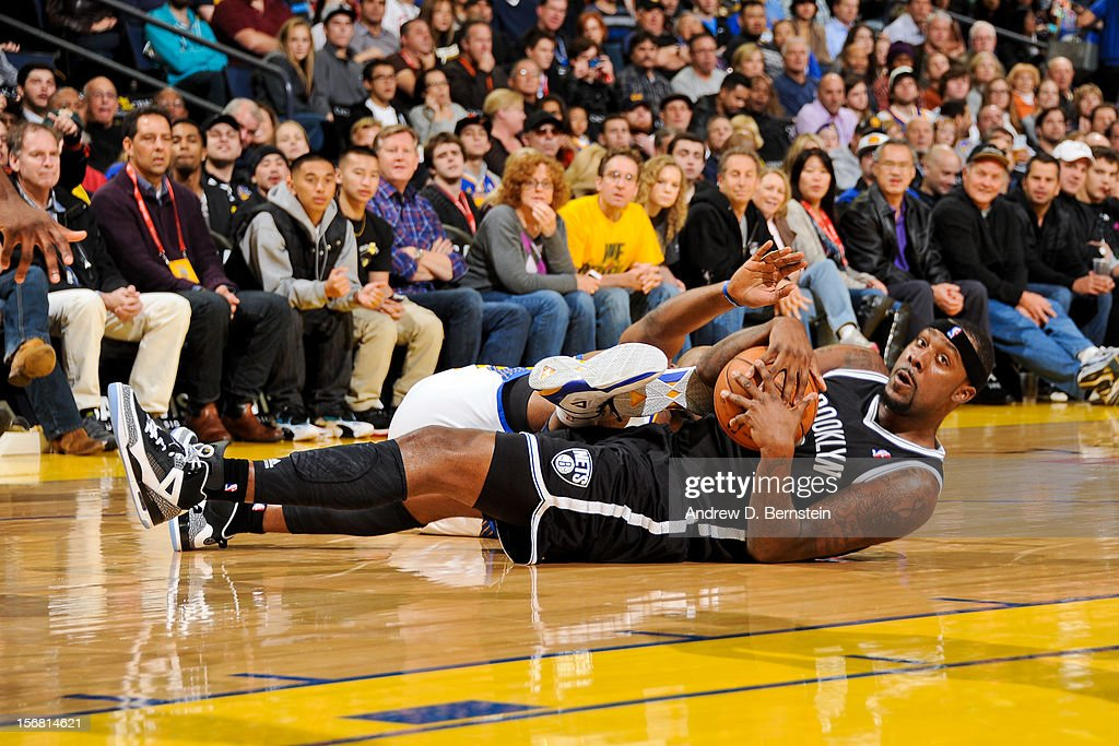 Andray Blatche #0 of the Brooklyn Nets controls a loose ball against the Golden State Warriors at Oracle Arena on November 21, 2012 in Oakland, California.