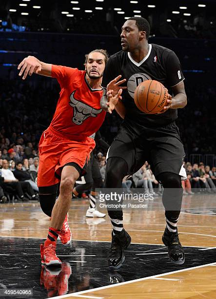 Andray Blatche of the Brooklyn Nets controls the ball against Joakim Noah of the Chicago Bulls during the third quarter at the Barclays Center on...