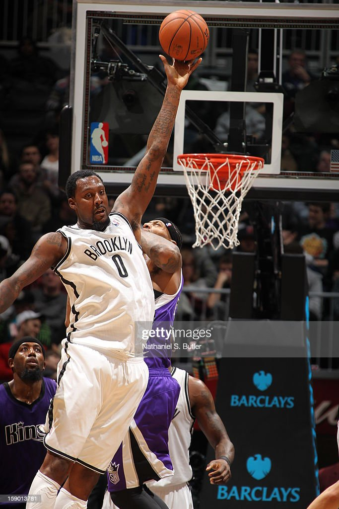 Andray Blatche #0 of the Brooklyn Nets deflects a pass against DeMarcus Cousins #15 of the Sacramento Kings on January 5, 2013 at the Barclays Center in the Brooklyn borough of New York City.