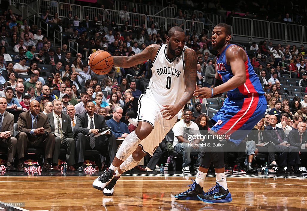 Andray Blatche #0 of the Brooklyn Nets dribbles against Greg Monroe #10 of the Detroit Pistons on April 17, 2013 at the Barclays Center in the Brooklyn borough of New York City.