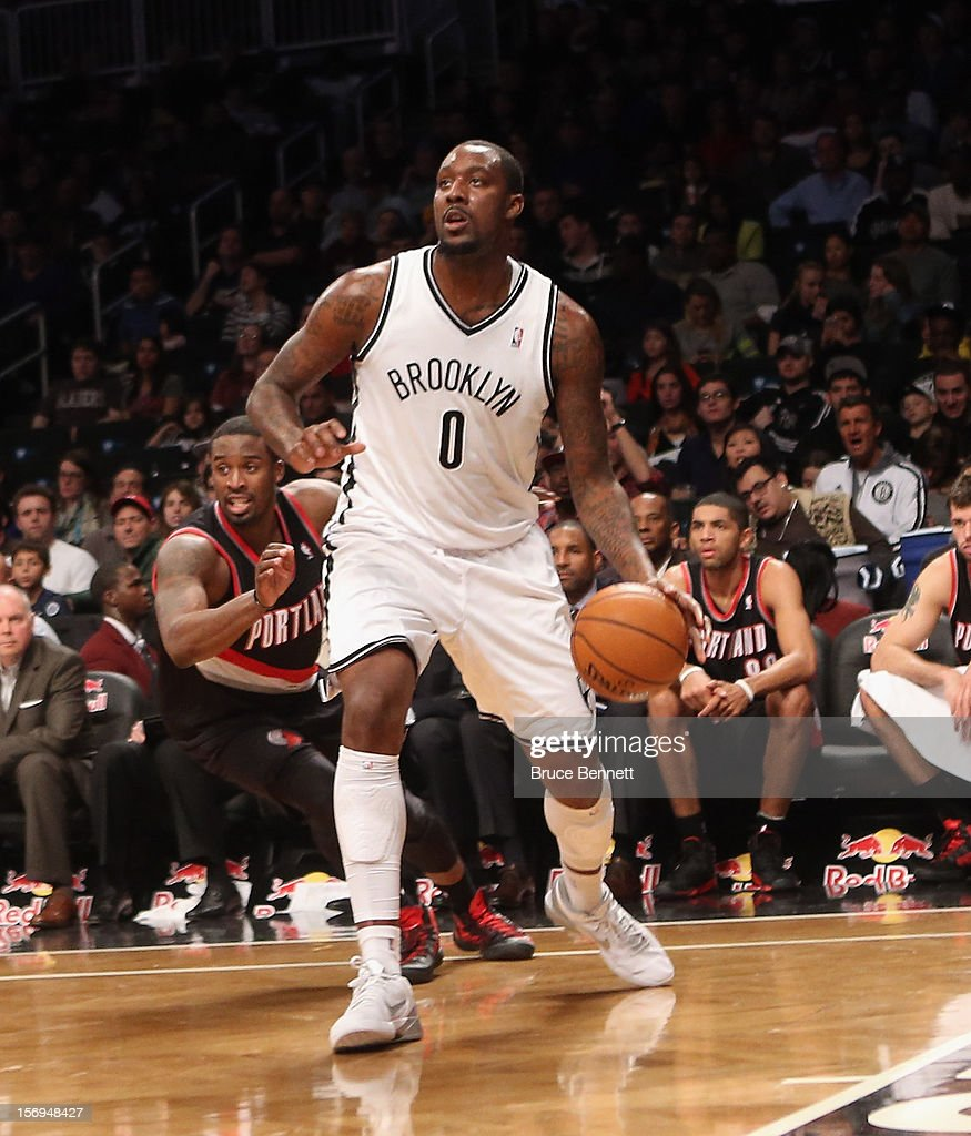 Andray Blatche #0 of the Brooklyn Nets dribbles the ball against the Portland Trail Blazers at the Barclays Center on November 25, 2012 in the Brooklyn borough of New York City.