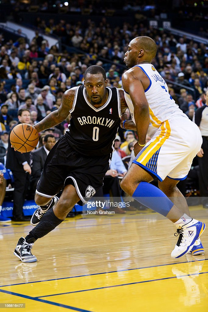 <a gi-track='captionPersonalityLinkClicked' href=/galleries/search?phrase=Andray+Blatche&family=editorial&specificpeople=4282797 ng-click='$event.stopPropagation()'>Andray Blatche</a> #0 of the Brooklyn Nets drives against <a gi-track='captionPersonalityLinkClicked' href=/galleries/search?phrase=Carl+Landry&family=editorial&specificpeople=4111952 ng-click='$event.stopPropagation()'>Carl Landry</a> #7 of the Golden State Warriors at Oracle Arena on November 21, 2012 in Oakland, California.